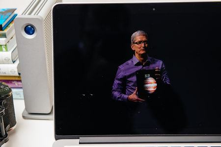 retina: PARIS, FRANCE - SEP 10, 2015: Apple Computers website on MacBook Pro Retina in a creative room environment showcasing Apple Event with Tim Cook holding the new iPad Editorial