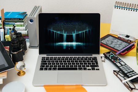 apple computers: PARIS, FRANCE - SEP 10, 2015: Apple Computers website on MacBook Pro Retina in a creative room environment showcasing the newly announced 3DTouch Editorial