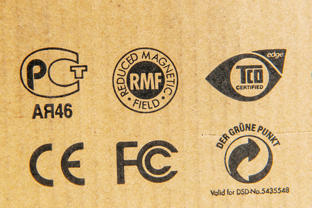 grune: LONDON, UNITED KINGDOM - MARCH 8, 2013: Diverse standards from across the globe on a cardboard box of a modern technology equipment Editorial