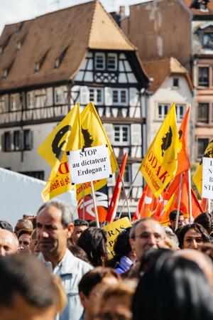dictator: STRASBOURG, FRANCE - OCT 4, 2015 Demonstrators protesting against Turkish President Recep Tayyip Erdogans visit to Strasbourg - Stope Erdogan the dictator placard