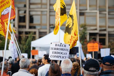 demonstrators: STRASBOURG, FRANCE - OCT 4, 2015 Demonstrators protesting against Turkish President Recep Tayyip Erdogans visit to Strasbourg - daesh terrorist and Erdogan is accomplice placard