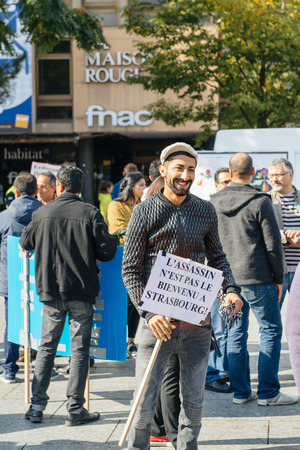 murderer: STRASBOURG, FRANCE - OCT 4, 2015 Demonstrators protesting against Turkish President Recep Tayyip Erdogans visit to Strasbourg - The murderer is not welcome to Strasbourg