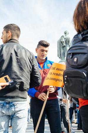 demonstrators: STRASBOURG, FRANCE - OCT 4, 2015 Demonstrators protesting against Turkish President Recep Tayyip Erdogans visit to Strasbourg - sad man holding placard Editorial