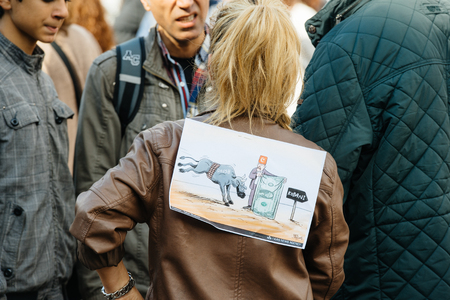 demonstrators: STRASBOURG, FRANCE - OCT 4, 2015 Demonstrators protesting against Turkish President Recep Tayyip Erdogans visit to Strasbourg - people protesting with placard