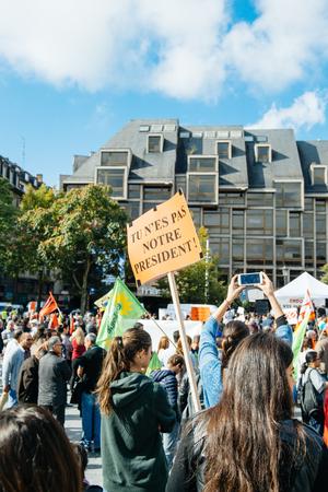 demonstrators: STRASBOURG, FRANCE - OCT 4, 2015 Demonstrators protesting against Turkish President Recep Tayyip Erdogans visit to Strasbourg - Youre not our president placard