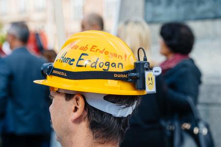 demonstrators: STRASBOURG, FRANCE - OCT 4, 2015 Demonstrators protesting against Turkish President Recep Tayyip Erdogans visit to Strasbourg - worker with helmet protesting