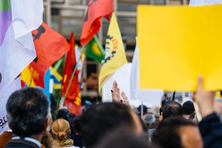 protester: STRASBOURG, FRANCE - OCT 4, 2015 Demonstrators protesting against Turkish President Recep Tayyip Erdogans visit to Strasbourg - protester clapping hands after speach