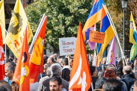 demonstrators: STRASBOURG, FRANCE - OCT 4, 2015 Demonstrators protesting against Turkish President Recep Tayyip Erdogans visit to Strasbourg - keine ignoranz, gegenuber terror placard