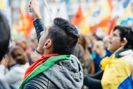 demonstrators: STRASBOURG, FRANCE - OCT 4, 2015 Demonstrators protesting against Turkish President Recep Tayyip Erdogans visit to Strasbourg - man waving flag