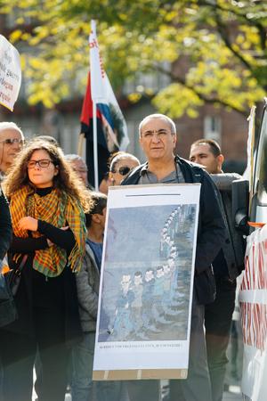 demonstrators: STRASBOURG, FRANCE - OCT 4, 2015 Demonstrators protesting against Turkish President Recep Tayyip Erdogans visit to Strasbourg - man holding placard