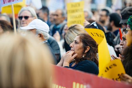 demonstrators: STRASBOURG, FRANCE - OCT 4, 2015 Demonstrators protesting against Turkish President Recep Tayyip Erdogans visit to Strasbourg - woman whistling to support the protesters