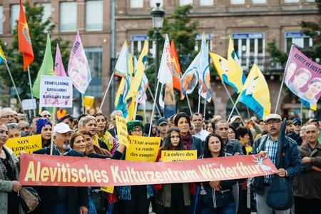 demonstrators: STRASBOURG, FRANCE - OCT 4, 2015 Demonstrators protesting against Turkish President Recep Tayyip Erdogans visit to Strasbourg - Alevites holding anti-Erdogan Placards Editorial