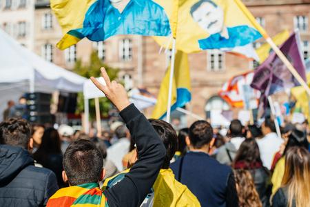 demonstrators: STRASBOURG, FRANCE - OCT 4, 2015 Demonstrators protesting against Turkish President Recep Tayyip Erdogans visit to Strasbourg - Vicotry hand sign at protest Editorial