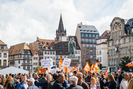 demonstrators: STRASBOURG, FRANCE - OCT 4, 2015 Demonstrators protesting against Turkish President Recep Tayyip Erdogans visit to Strasbourg - people protesting in PLace Kleber
