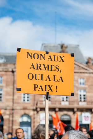 demonstrators: STRASBOURG, FRANCE - OCT 4, 2015 Demonstrators protesting against Turkish President Recep Tayyip Erdogans visit to Strasbourg - No for weapons, yeas for peace Editorial