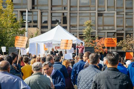 speach: STRASBOURG, FRANCE - OCT 4, 2015 Demonstrators protesting against Turkish President Recep Tayyip Erdogans visit to Strasbourg - people listening to speach