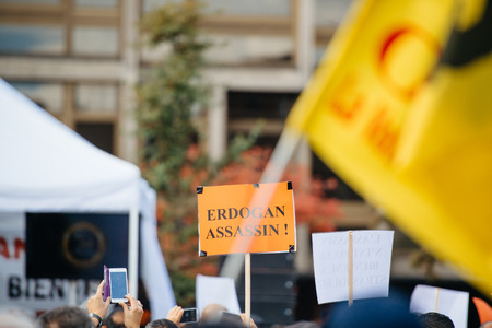 recep tayyip erdogan: STRASBOURG, FRANCE - OCT 4, 2015 Demonstrators protesting against Turkish President Recep Tayyip Erdogans visit to Strasbourg - Erdogan murderer palcard Editorial