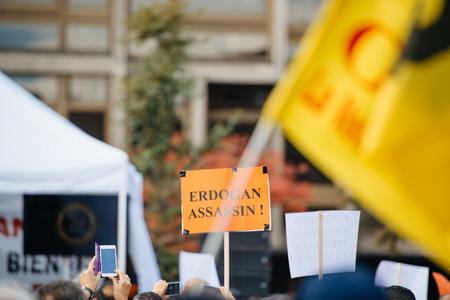 murderer: STRASBOURG, FRANCE - OCT 4, 2015 Demonstrators protesting against Turkish President Recep Tayyip Erdogans visit to Strasbourg - Erdogan murderer palcard Editorial