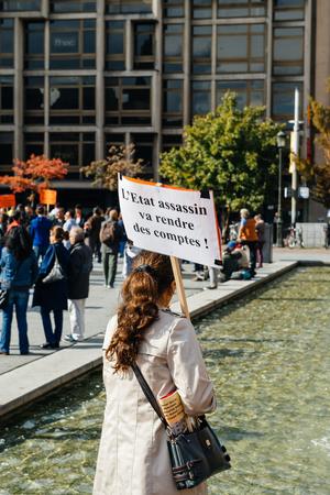 demonstrators: STRASBOURG, FRANCE - OCT 4, 2015 Demonstrators protesting against Turkish President Recep Tayyip Erdogans visit to Strasbourg - women holding placard