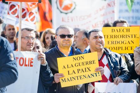 demonstrators: STRASBOURG, FRANCE - OCT 4, 2015 Demonstrators protesting against Turkish President Recep Tayyip Erdogans visit to Strasbourg - Editorial