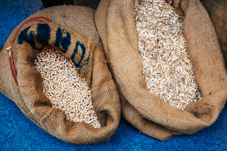 biomass: Pellets compressed organic matter, or biomass made from sawdust in their organic bags next to eachother