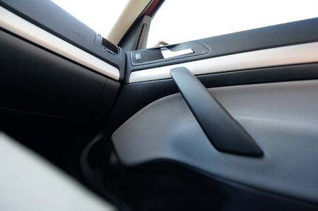 handler: Interior of a modern car seen from inside with Airbag, door handler and other details Stock Photo