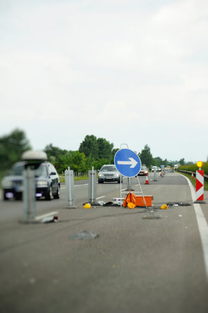 insurance themes: Blue sigh with arrow on Hungarian highway after an accident
