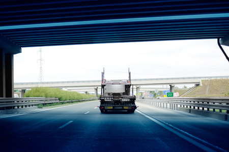 exiting: HUNGARY - JULY 04, 2011: Truck trailer exiting Hungarian tunnel with not other cars on the highway