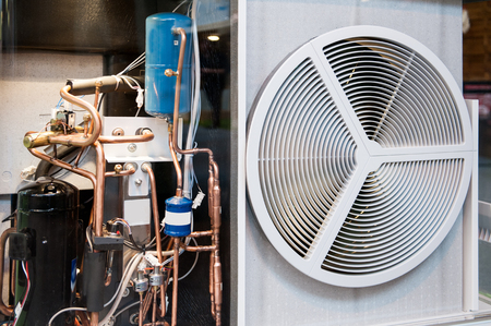 ac: Seen through heating and AC air conditioning unit used in a residential home or business office Stock Photo
