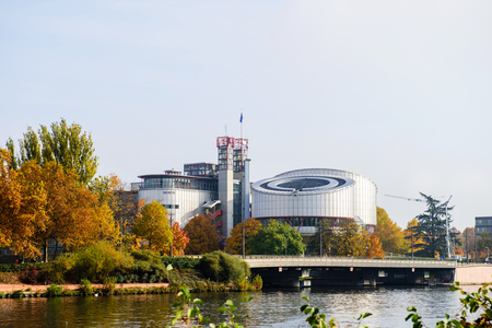 juror: European Court of human Rights building near Ill river in Strasbourg, Alsace, France