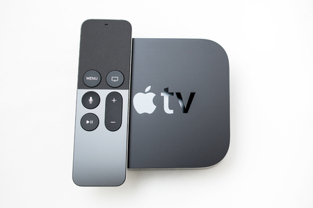 motion sensor: PARIS, FRANCE - NOV 10, 2015: New Apple TV media streaming  player microconsole by Apple Computers -  .  It has new touch remote swipe-to-select with integrated Siri and motion sensor Editorial