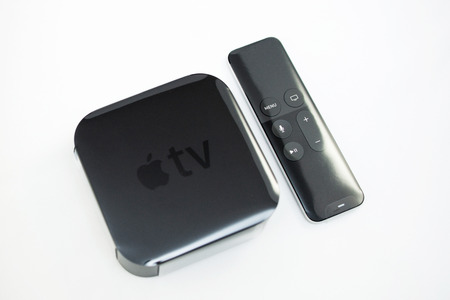 motion sensor: PARIS, FRANCE - NOV 10, 2015: New Apple TV media streaming  player microconsole by Apple Computers - unboxing plastic film. It has new touch remote swipe-to-select with integrated Siri and motion sensor