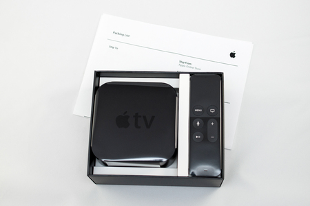 motion sensor: PARIS, FRANCE - NOV 10, 2015: New Apple TV media streaming  player microconsole by Apple Computers - unboxing and packing list. It has new touch remote swipe-to-select with integrated Siri and motion sensor