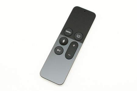motion sensor: PARIS, FRANCE - NOV 10, 2015: New Apple TV media streaming  player microconsole by Apple Computers futuristic touch remote swipe-to-select with integrated Siri and motion sensor