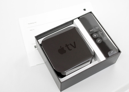 motion sensor: PARIS, FRANCE - NOV 10, 2015: New Apple TV media streaming  player microconsole by Apple Computers - unboxing over invoice. It has new touch remote swipe-to-select with integrated Siri and motion sensor