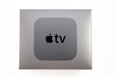 motion sensor: PARIS, FRANCE - NOV 10, 2015: New Apple TV media streaming  player microconsole by Apple Computers - cardboard box with logo.  It has new touch remote swipe-to-select with integrated Siri and motion sensor Editorial
