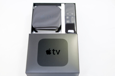 motion sensor: PARIS, FRANCE - NOV 10, 2015: New Apple TV media streaming  player microconsole by Apple Computers - unboxing process. It has new touch remote swipe-to-select with integrated Siri and motion sensor Editorial