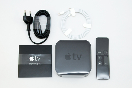 motion sensor: PARIS, FRANCE - NOV 10, 2015: New Apple TV media streaming  player microconsole by Apple Computers - all accessories from above.  It has new touch remote swipe-to-select with integrated Siri and motion sensor Editorial