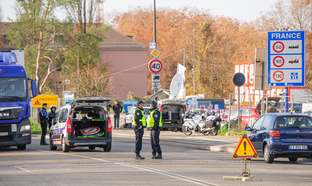 mobilization: STRASBOURG, FRANCE - NOV 14 2015: French Police checking vehicles on the Bridge of Europe between Strasbourg and Kehl Germany, as a security measure in the wake of attacks in Paris