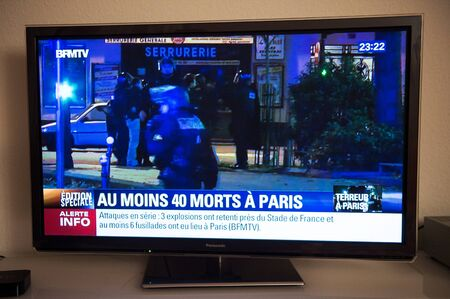 mobilization: French Television reporting live as rescuers working on the schene of the attack. At least 40 people were killed across Paris, with explosions outside the national stadium where France was hosting German team Editorial