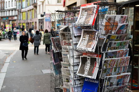 counter terrorism: STRASBOURG, FRANCE - 14 NOV, 2015: The front covers of International newspapers display headlining the terrorist attacks yesterday in Paris