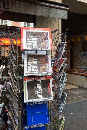 mobilization: STRASBOURG, FRANCE - 14 NOV, 2015: The front covers of International newspapers display headlining the terrorist attacks yesterday in Paris