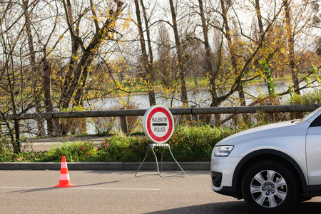 mobilization: STRASBOURG, FRANCE - NOV 14 2015: French Police checking vehicles on the Bridge of Europe between Strasbourg and Kehl Germany, as a security measure in the wake of attacks in Paris - slow down pilice sign Editorial