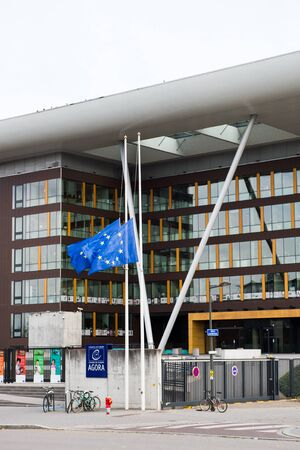 symbol victim: STRASBOURG, FRANCE - 14 Nov 2015: European Union Flag flies at half-mast in front of the Counci lof Europe building, Agora - following an terrorist attack in Paris