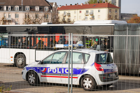 counter terrorism: STRASBOURG, FRANCE - NOV 14 2015: French Police checking vehicles on the Bridge of Europe between Strasbourg and Kehl Germany, as a security measure in the wake of attacks in Paris - officer body searching bus travelers Editorial
