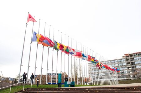 symbol victim: STRASBOURG, FRANCE - 14 Nov 2015: All European Union Flag flies at half-mast in front of the Council of Europe following an terrorist attack in Paris