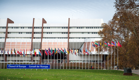 justice for all: STRASBOURG, FRANCE - 14 Nov 2015: All European Union Flag flies at half-mast in front of the Council of Europe following an terrorist attack in Paris