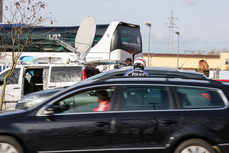 mobilization: STRASBOURG, FRANCE - NOV 14 2015: French Police checking vehicles on the Bridge of Europe between Strasbourg and Kehl Germany, as a security measure in the wake of attacks in Paris - officer inspecting car
