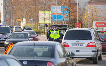 mobilization: STRASBOURG, FRANCE - NOV 14 2015: French Police checking vehicles on the Bridge of Europe between Strasbourg and Kehl Germany, as a security measure in the wake of attacks in Paris - two officers inspecting cars
