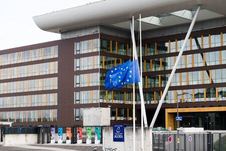 justice for all: STRASBOURG, FRANCE - 14 Nov 2015: European Union Flag flies at half-mast in front of the Counci lof Europe building, Agora - following an terrorist attack in Paris